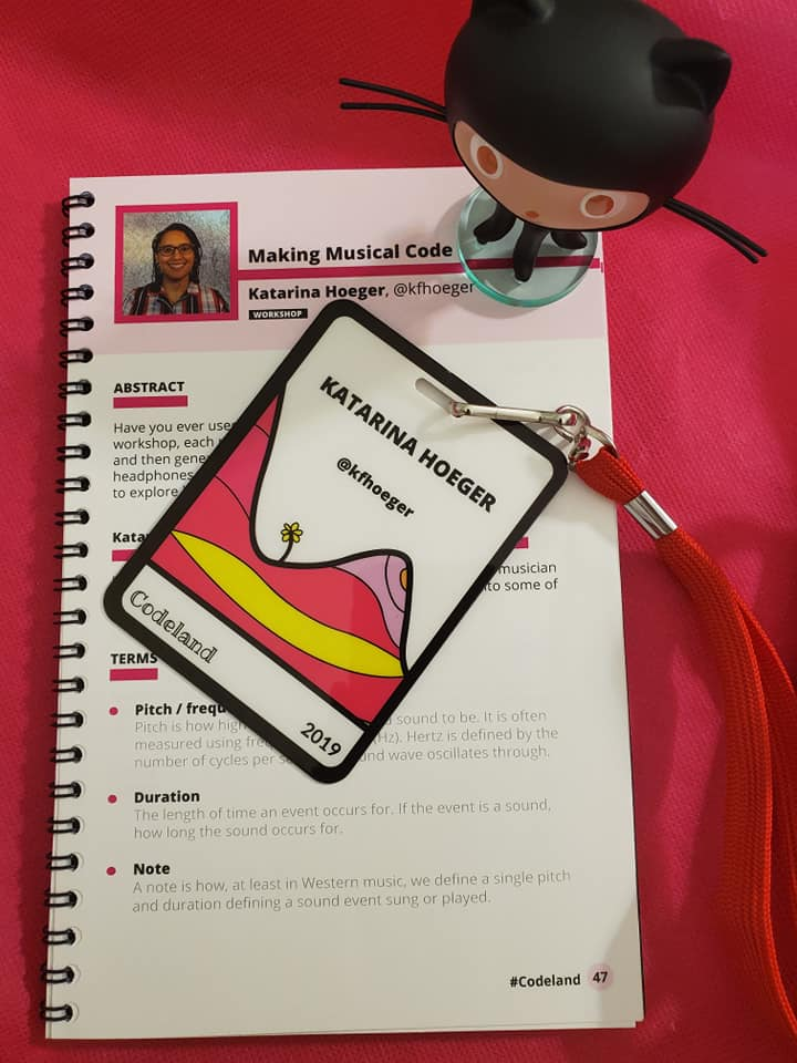 Codeland program, octocat, and a speaker lanyard on a pink background.